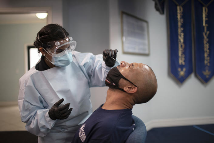 A health care worker use a nasal swab to test Eric Rodriguez for COVID-19 at a pop up testing site at the Koinonia Worship Center and Village on July 22, 2020 in Pembroke Park, Florida. (Joe Raedle/Getty Images)