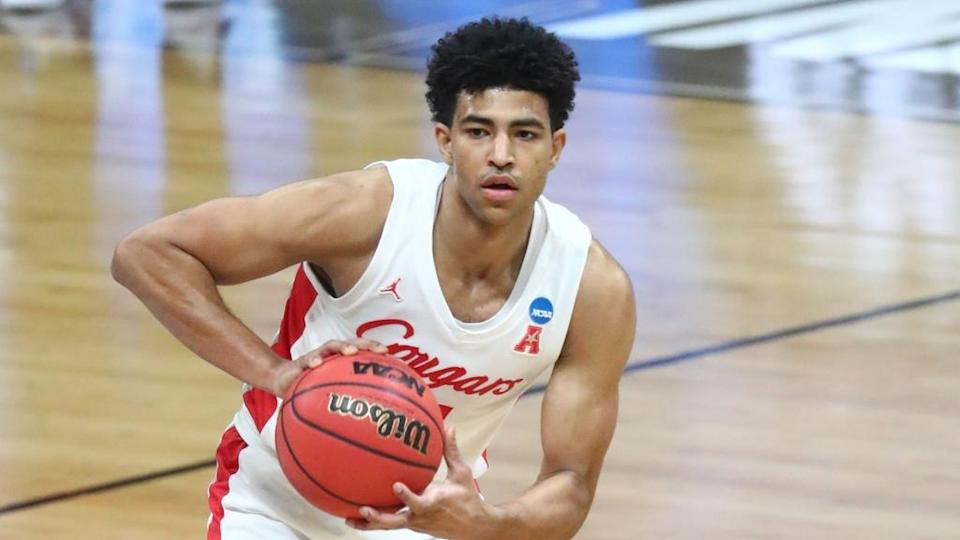 Quentin Grimes holds basketball at the top of the key