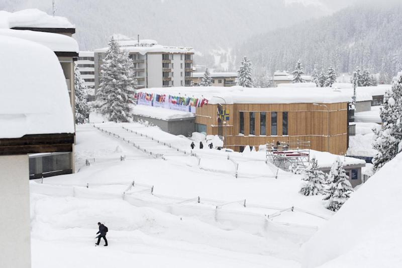 Snowy: Davos has been hit with heavy snow before the summit (EPA)