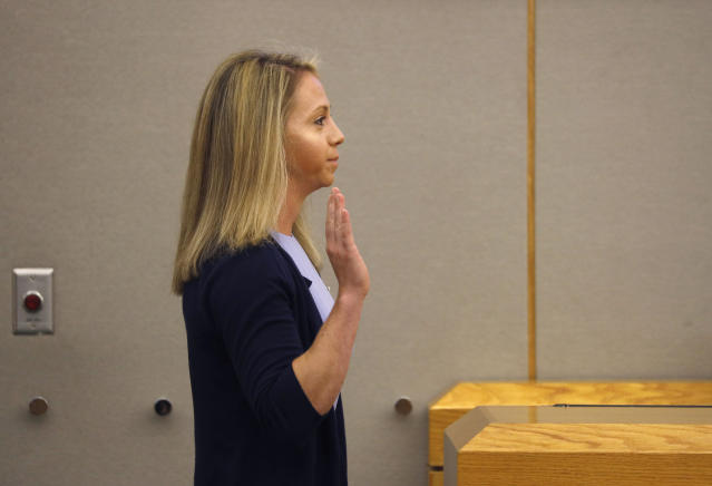Fired Dallas Police Officer Amber Guyger is sworn in by Judge Tammy Kemp before taking the witness stand in her own murder defense in the 204th District Court at the Frank Crowley Courts Building in Dallas, Friday, Sept. 27, 2019. Guyger shot and killed Botham Jean, an unarmed 26-year-old neighbor in his own apartment last year. She said she mistook his fourth-floor apartment for her own. (Tom Fox/The Dallas Morning News via AP, Pool)