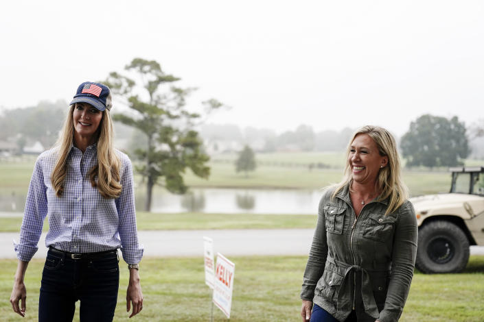 Sen. Kelly Loeffler, R-Ga., left, and Republican congressional candidate Marjorie Taylor Greene, right, arrive a news conference on Thursday, Oct. 15, 2020, in Dallas, Ga. (AP Photo/Brynn Anderson)
