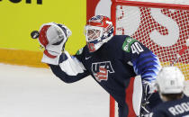 Goaltenders Cal Petersen of the US makes a save during the Ice Hockey World Championship group B match between United States and Kazakhstan at the Arena in Riga, Latvia, Tuesday, May 25, 2021. (AP Photo/Sergei Grits)