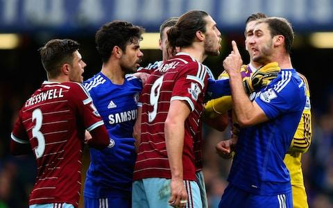 Andy Carroll argues with Branislav Ivanovic - Credit: Getty images