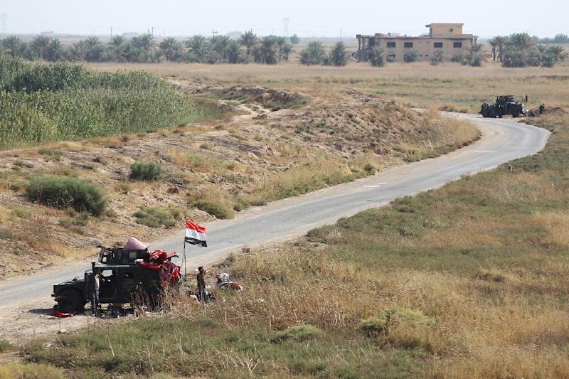 Iraqi forces are posted on a road near Kurdish peshmerga positions on the southern outskirts of Kirkuk city on October 14 (AFP Photo/AHMAD AL-RUBAYE)