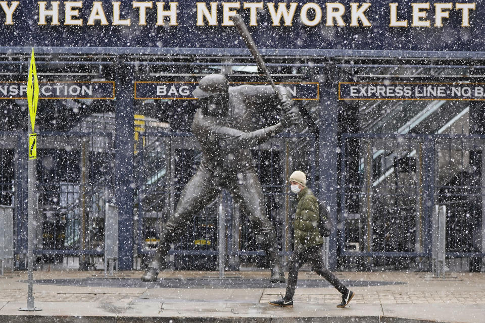 Snow falls on a statue of Pittsburgh Pirates baseball Hall of Famer Willie Stargell, outside PNC Park on Pittsburgh's Northside, Thursday, April 1, 2021. The Pirates open the season in Chicago today against the Chicago Cubs. The Pirates' home opener is April 8, against the Chicago Cubs. (AP Photo/Gene J. Puskar)