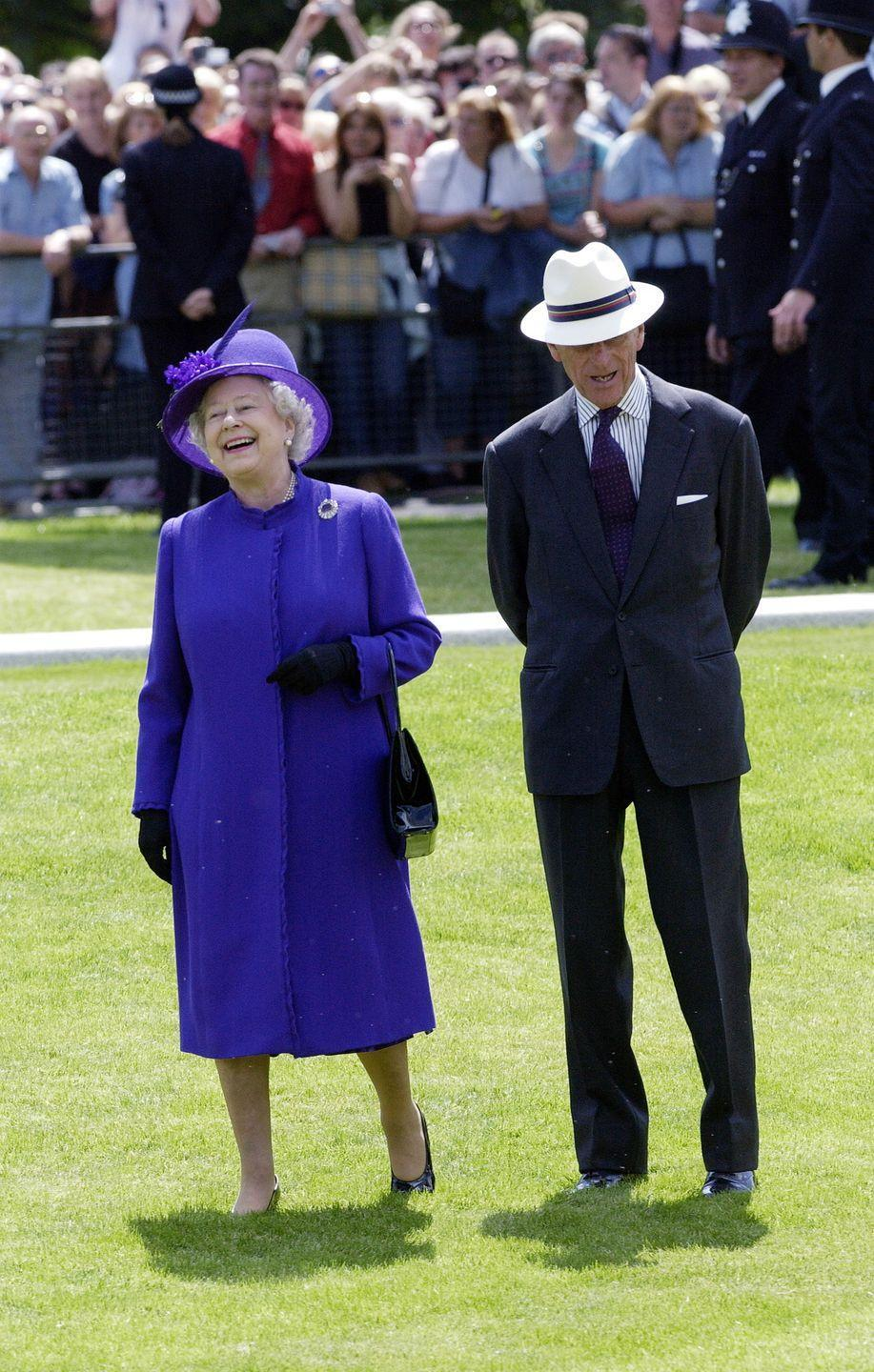 <p>The Queen laughs as she walks with Prince Philip in his Panama sunhat after opening the fountain built in memory of Diana, Princess of Wales, in London's Hyde Park.</p>