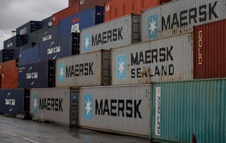 Empty Maersk shipping containers are seen stacked at Peel Ports container terminal in Liverpool