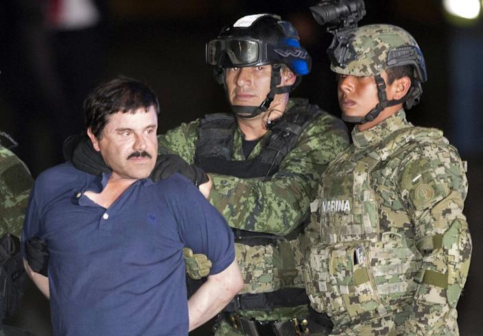 """Mexican drug kingpin Joaquin """"El Chapo"""" Guzman and two members of the armed forces."""
