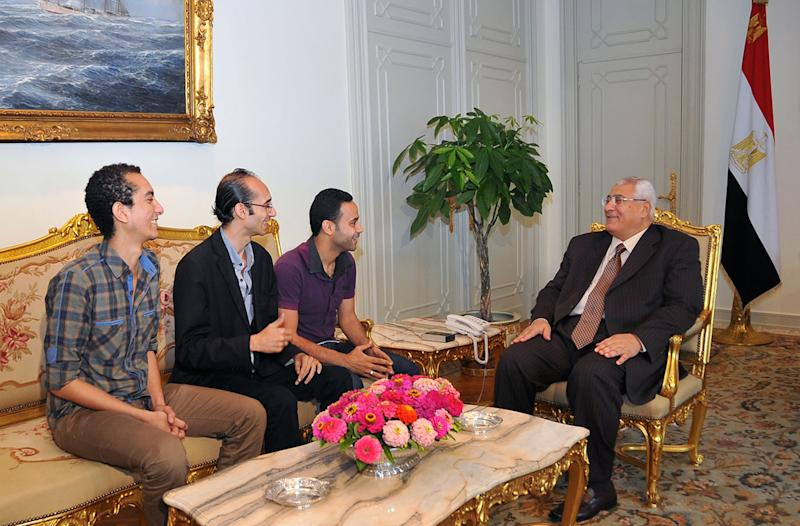 FILE - This Saturday, July 6, 2013 file image released by the office of the Egyptian Presidency shows Tamarod opposition leaders from left, Hassan Shahin, Mohammed Abdel-Aziz and Mahmoud Badr meeting with interim president Adly Mansour, right, at the presidential palace. Liberal and youth movements that backed the military's removal of Islamist President Mohammed Morsi are now fighting to make their calls for reform heard as they push back against the military's strong grip on the new leadership. At stake is the hope that the Arab world's most populous nation will emerge from more than two years of turmoil as a democracy. (AP Photo/Sheriff Abd El Minoem, File)