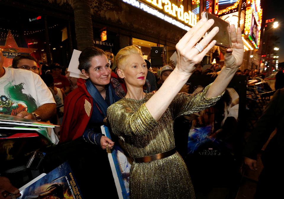 """Cast member Tilda Swinton poses with a fan at the premiere of """"Doctor Strange"""" in Hollywood, California U.S., October 20, 2016.   REUTERS/Mario Anzuoni"""