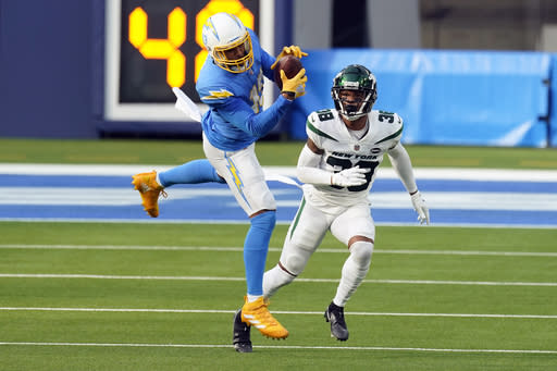 Los Angeles Chargers wide receiver Keenan Allen, left, catches the ball in front of New York Jets cornerback Lamar Jackson during the first half of an NFL football game Sunday, Nov. 22, 2020, in Inglewood, Calif. (AP Photo/Jae C. Hong)