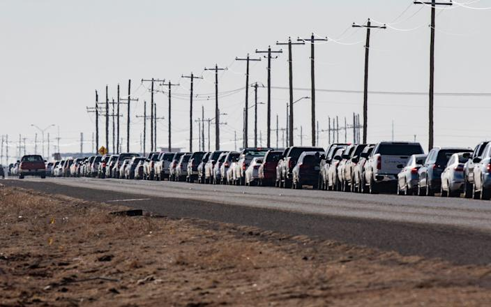 Motorists wait in line for the second dose of the Pfizer vaccine on Texas Loop 338 - Odessa American