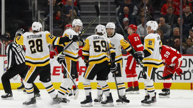 Pittsburgh Penguins center Evgeni Malkin, second from left, celebrates his goal with teammates against the Detroit Red Wings in the second period of an NHL hockey game Saturday, Dec. 7, 2019, in Detroit. (AP Photo/Paul Sancya)