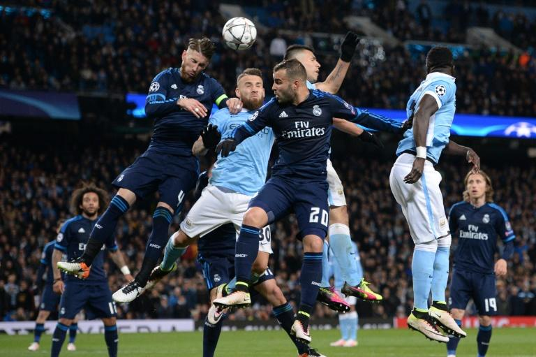 Real Madrid's defender Sergio Ramos (L), Manchester City's defender Nicolas Otamendi (2L) and Real Madrid's forward Jese Rodriguez (3L) go up for a header during the UEFA Champions League semi-final first leg match on April 26, 2016