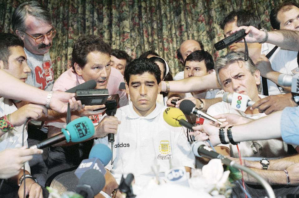 Diego Maradona is surrounded by the media after he was tested positive for doping at the 1994 World Cup in the United States. (PHOTO: AP/Tim Sharp)