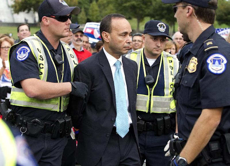 Rep. Luis Gutierrez, D-Ill., is arrested by U.S. Capitol Police officers on Capitol Hill during a immigration rally in Washington, on Tuesday, Oct. 8, 2013. ( AP Photo/Jose Luis Magana)