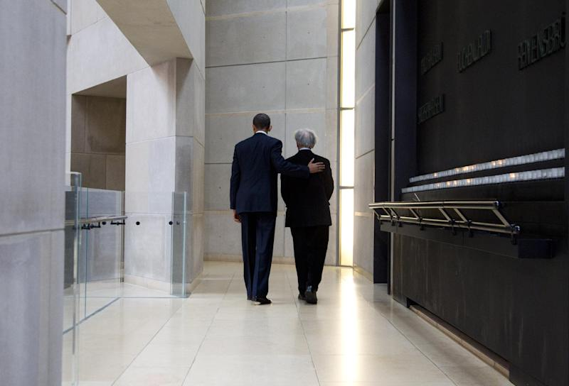 President Barack Obama and Nobel Peace Prize laureate and Holocaust survivor Elie Wiesel leave after lighting candles in the Hall of Remembrance as they toured the Holocaust Memorial Museum in Washington, Monday, April 23, 2012. (AP Photo/Carolyn Kaster)