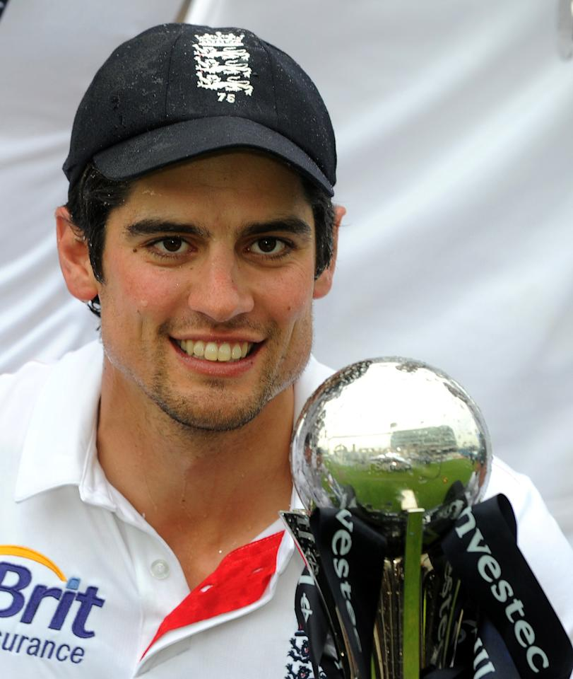 England's Alastair Cook celebrates with the series trophy after winning the test series against new Zealand after the Second Investec Test match at Headingley, Leeds.
