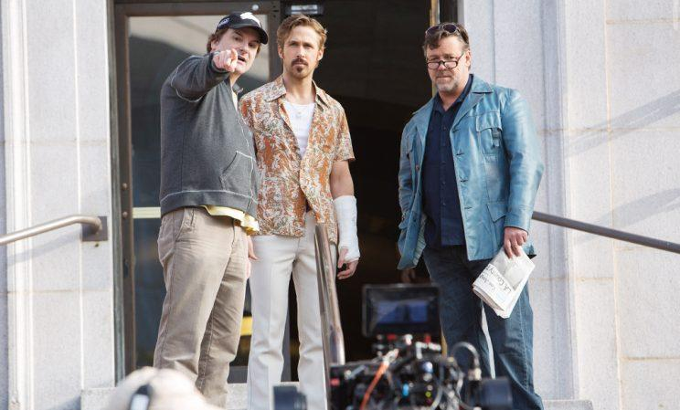 (From left) Director Shane Black, Ryan Gosling, and Russell Crowe, on set for 'The Nice Guys,' 2016. (Photo: Daniel McFadden/ Everett Collection