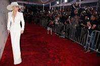 <p>Was Lady Gaga sending a political message with her white pantsuit and fedora? The Hillary Clinton supporter, who protested President-elect Donald Trump recently, could've worn the symbolic color (suffragettes often wore it to protest voting inequality) and silhouette to make a statement. <em>(Photo: Getty Images)</em> </p>