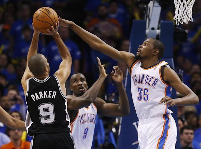 Oklahoma City Thunder forward Kevin Durant (35) blocks a shot by San Antonio Spurs guard Tony Parker (9), of France, in the second quarter of Game 3 of an NBA basketball playoff series in the Western Conference finals, Sunday, May 25, 2014, in Oklahoma City. Oklahoma City won 106-97. (AP Photo/Sue Ogrocki)