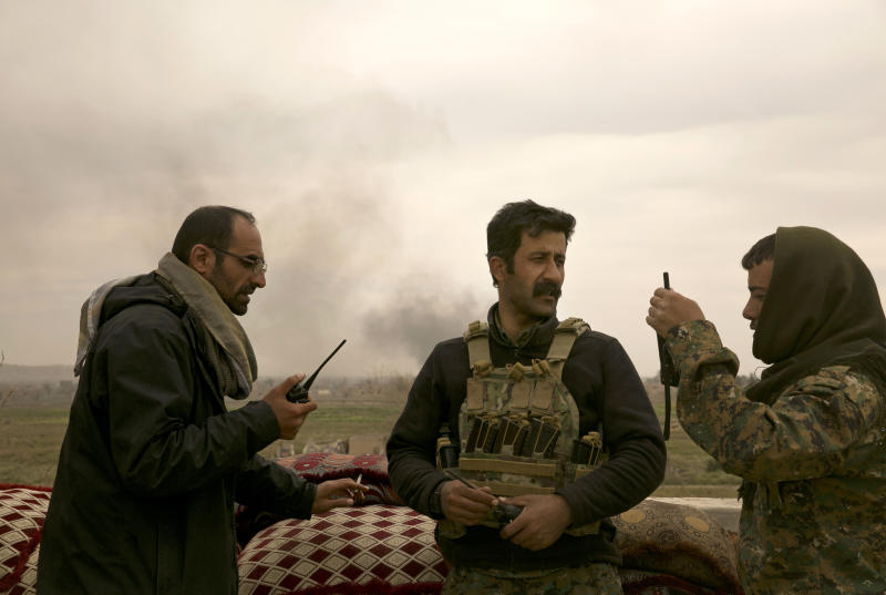 U.S.-backed Syrian Democratic Forces (SDF) command the battle to oust Islamic State militants from Baghouz, Syria, Wednesday, March 13, 2019. U.S.-backed Syrian forces say Islamic State militants are putting up a desperate fight against their advances and have staged a counterattack from the tiny speck of land the extremists still hold in eastern Syria. (AP Photo/Maya Alleruzzo)