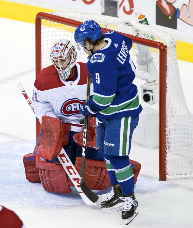 Montreal Canadiens goalie Carey Price (31) makes a save as Vancouver Canucks' Brendan Leipsic (9) looks on during the second period of an NHL hockey game in Vancouver, British Columbia, Saturday, Nov. 17, 2018. (Darryl Dyck/The Canadian Press via AP)