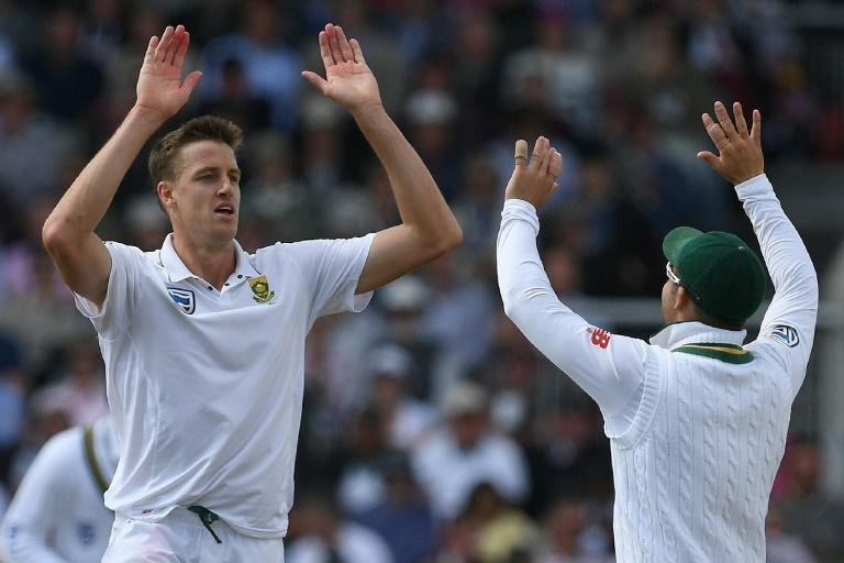 South Africa's Morne Morkel (left) celebrates taking the wicket of England's Dawid Malan on the first day of the fourth Test at Old Trafford on August 4, 2017