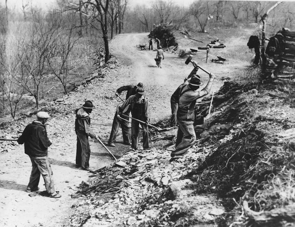 Works Progress Administration (WPA) workers build a farm-to-market road along Knob Creek in Tennessee on March 9, 1936.