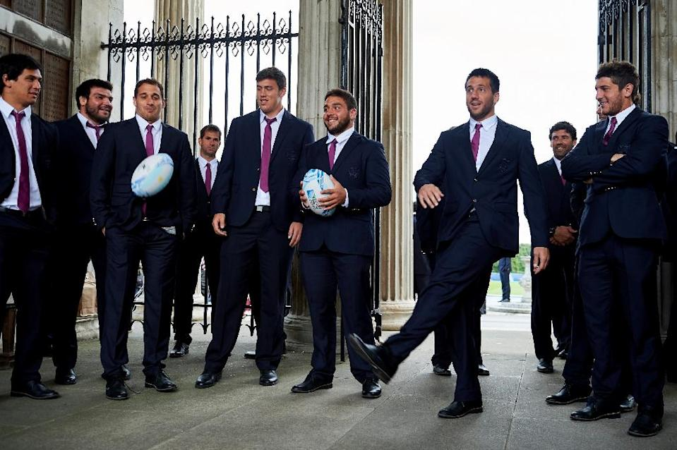 Argentina fly-half Santiago Gonzalez Iglesias kicks a ball at the team's official welcoming ceremony at Haileybury School in Hailey, central England on September 14, 2015 (AFP Photo/Niklas Halle'n)