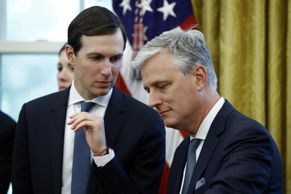 FILE - In this Nov. 13, 2019, file photo, senior adviser Jared Kushner, left, talks with national security adviser Robert O'Brien as President Donald Trump speaks at a news conference with Turkish President Recep Tayyip Erdogan in the East Room of the White House in Washington. (AP Photo/Patrick Semansky, File)