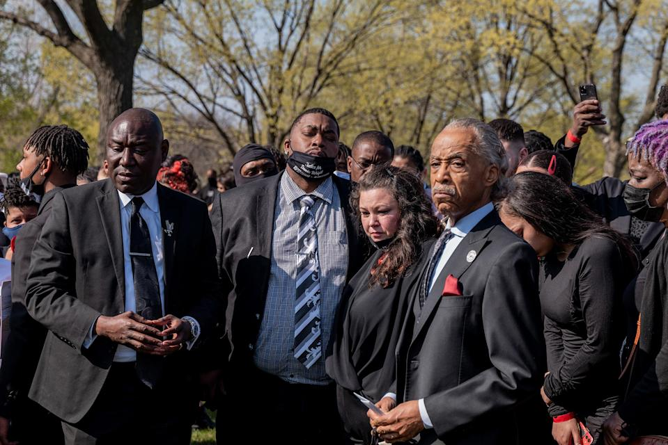"""Aubrey and Katie Wright, the parents of Daunte Wright, stand with Crump (far left) and Sharpton (far right), at Lakewood Cemetery after their son's funeral in Minneapolis on April 22.<span class=""""copyright"""">Ruddy Roye for TIME</span>"""