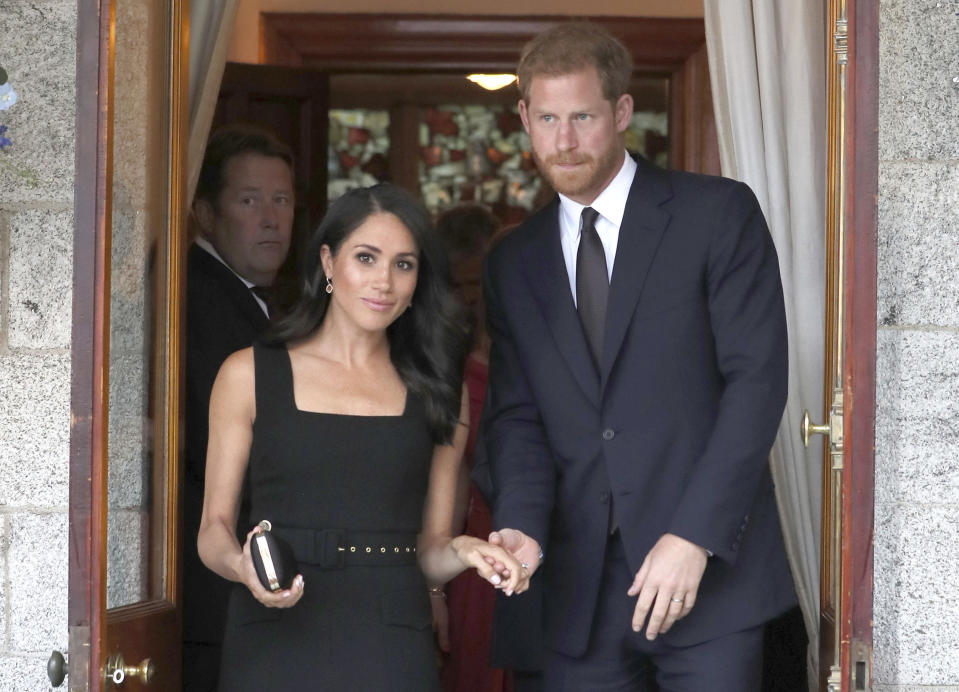 Britain's Prince Harry and Meghan Duchess of Sussex attend a Summer Party at the British Ambassador's residence in Dublin, Ireland, Tuesday July 10, 2018. The royal couple are on a two day visit to Ireland. (Brian Lawless/PA via AP)