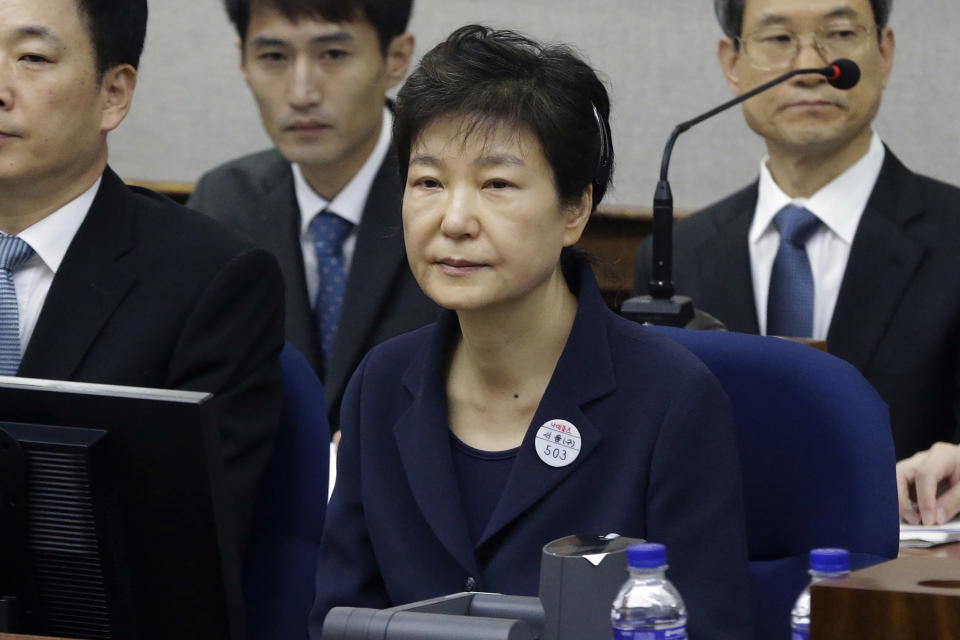 FILE - In this May 23, 2017, file photo, former South Korean President Park Geun-hye, front, sits for her trial at the Seoul Central District Court in Seoul, South Korea. South Korea's top court upheld 20-year prison term for Park over corruption on Thursday, Jan. 14, 2021. (AP Photo/Ahn Young-joon, Pool, File)
