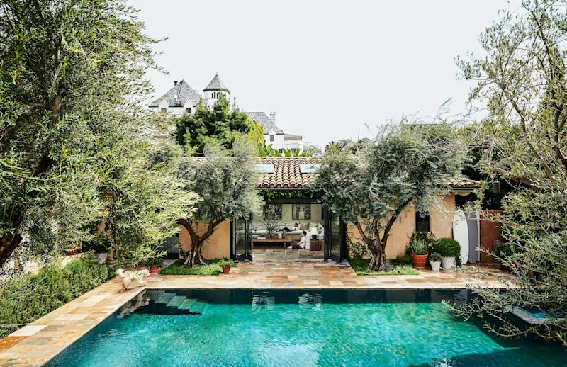 To preserve their views of Chateau Marmont and downtown L.A., the Misczynskis bought the lot adjacent to their home to build a pool, poolhouse, pergola, and garden.