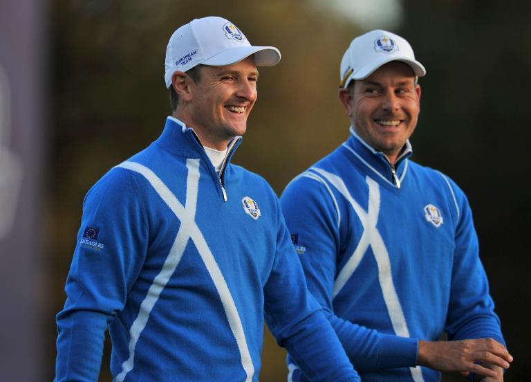 Team Europe's Justin Rose of England (L) and Henrik Stenson of Sweden walk away from the first tee during the first day of the Ryder Cup at Gleneagles on September 26, 2014 (AFP Photo/Glyn Kirk)
