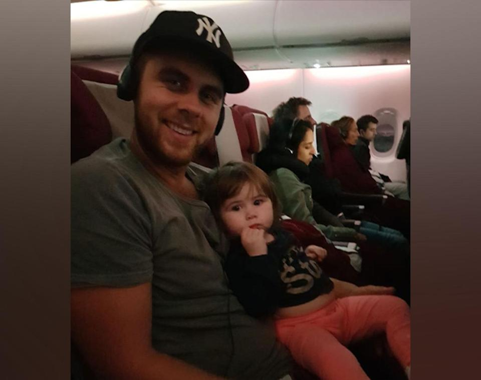 A man called Kev has been hailed a hero after helping settle a stranger's screaming toddler to sleep on a long-haul flight to London. Source: Anjee Watson