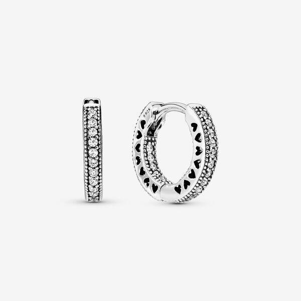"""<p><strong>Pandora</strong></p><p>pandora.net</p><p><strong>$16.25</strong></p><p><a href=""""https://go.redirectingat.com?id=74968X1596630&url=https%3A%2F%2Fus.pandora.net%2Fen%2Fjewelry%2Fearrings%2Fsilver-earrings%2Fpave-heart-hoop-earrings%2F296317CZ.html%3Fcgid%3Dearrings-silver-earrings%23position%3Dtop%26src%3DcategorySearch%26start%3D23%26cgid%3Dearrings-silver-earrings%26productscount%3D54&sref=https%3A%2F%2Fwww.oprahmag.com%2Fstyle%2Fg32948480%2Fbest-earrings-for-sensitive-ears%2F"""" rel=""""nofollow noopener"""" target=""""_blank"""" data-ylk=""""slk:SHOP NOW"""" class=""""link rapid-noclick-resp"""">SHOP NOW</a></p><p>These sterling silver pavé hoops are perfectly sized for day or evening. </p>"""