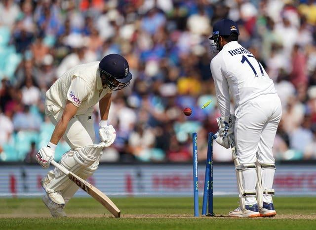 Dawid Malan, left, survives a run-out chance against India