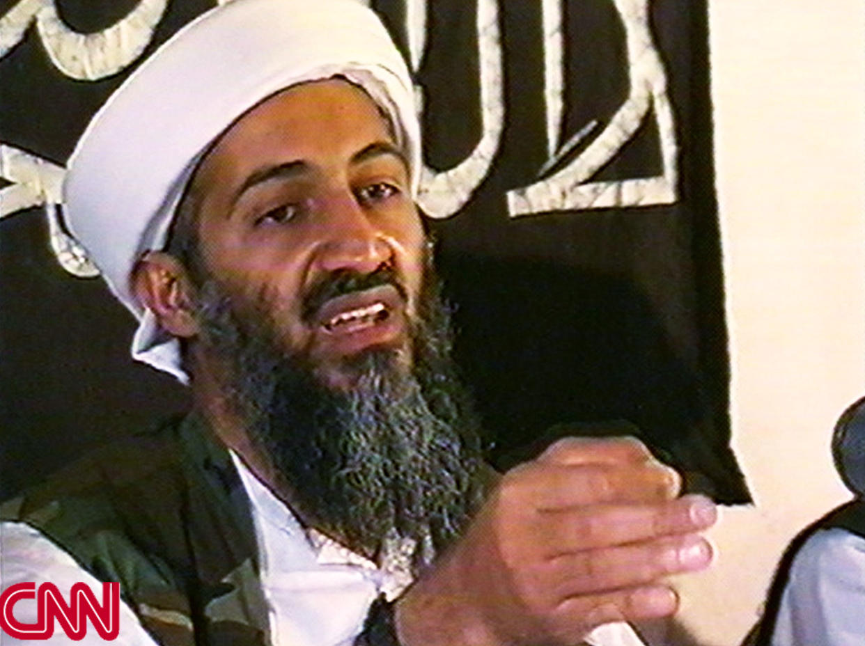 AFGHANISTAN - MAY 26: (JAPAN OUT)(VIDEO CAPTURE) This image taken from a collection of videotapes obtained by CNN shows Osama Bin Laden, the leader of the terrorist group al Qaeda, at a press conference on May 26, 1998 in Afghanistan. The tape showing this image was included in a large collection of videotapes obtained by CNN from a secret location in Afghanistan. Although it cannot be positively verified that the tapes were created by the al Qaeda terrorist network the tapes do show dramatic and sometimes repulsive images of poison gas experiments on dogs, instructions on making TNT and weapons training by men speaking Arabic. (Photo by CNN via Getty Images)