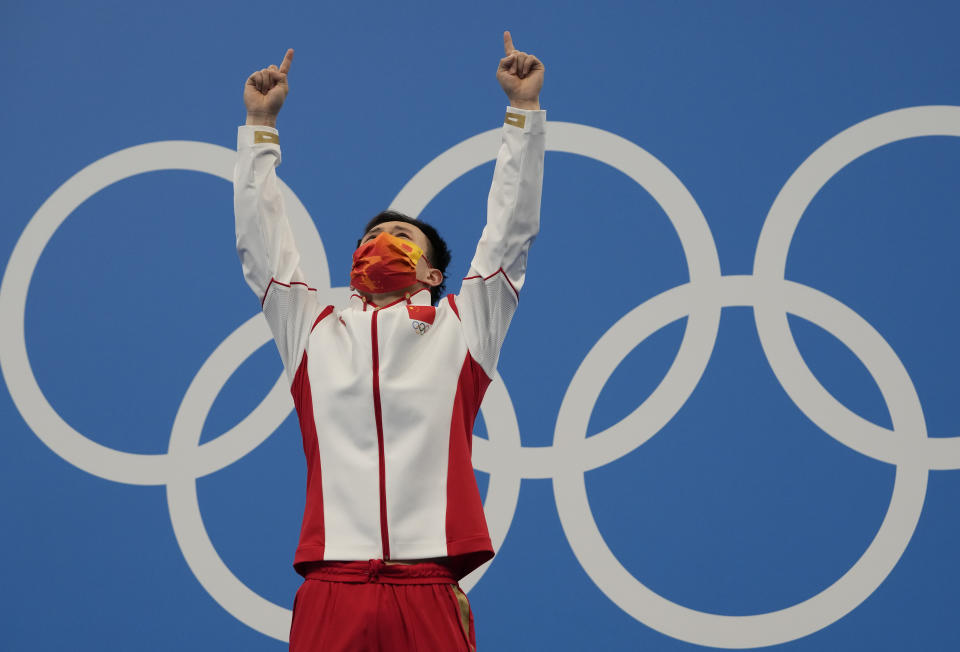 Xie Siyi of China reacts after winning gold medal in men's diving 3m springboard final at the Tokyo Aquatics Centre at the 2020 Summer Olympics, Tuesday, Aug. 3, 2021, in Tokyo, Japan. (AP Photo/Dmitri Lovetsky)