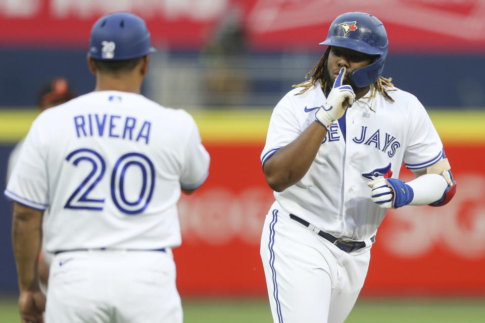 Toronto Blue Jays' Vladimir Guerrero Jr., right, celebrates his home run during the second inning of a baseball game against the Baltimore Orioles in Buffalo, N.Y., Thursday, June 24, 2021. (AP Photo/Joshua Bessex)