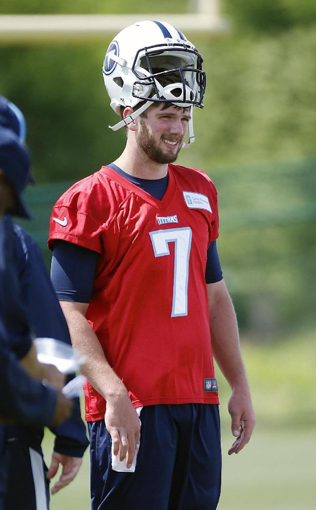 Tennessee Titans quarterback Zach Mettenberger, from LSU, watches teammates run a drill during NFL football rookie minicamp practice on Friday, May 16, 2014, in Nashville, Tenn. (AP Photo/Mark Humphrey)