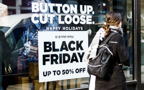 PHOTO: A person walks past a sign for a Black Friday related sale in New York, Nov. 25, 2019. (Justin Lane/EPA via Shutterstock)