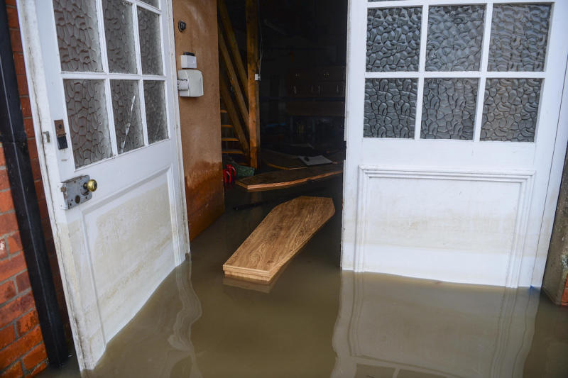 The coffins were washed off their stands by floodwater in Fishlake, South Yorkshire (Picture: SWNS)