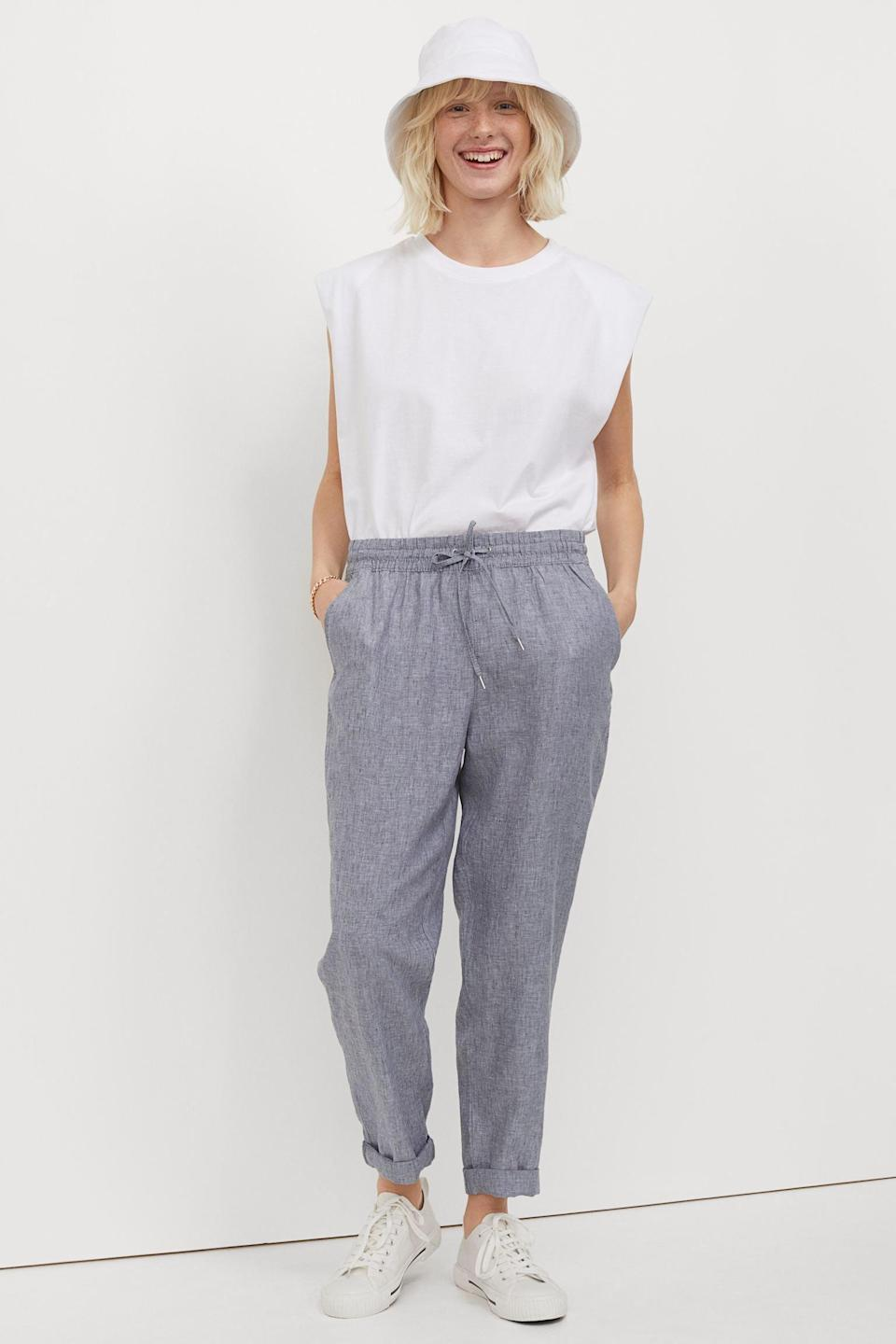 """<h2>H&M Linen Joggers</h2><br>As the saying goes, if it ain't broke, don't fix it. Just because we live in our cotton sweats at home doesn't mean we can't find a more suitable alternative for our travel excursions. Consider a pair of linen joggers. The breathable fabric leaves you comfortable everywhere, and is chic enough to wear throughout your vacation (especially if it's a trip near the beach).<br><br><em>Shop <strong><a href=""""https://www2.hm.com/en_us/index.html"""" rel=""""nofollow noopener"""" target=""""_blank"""" data-ylk=""""slk:H&M"""" class=""""link rapid-noclick-resp"""">H&M</a></strong></em><br><br><strong>H&M</strong> Linen Joggers, $, available at <a href=""""https://go.skimresources.com/?id=30283X879131&url=https%3A%2F%2Fwww2.hm.com%2Fen_us%2Fproductpage.0954891004.html"""" rel=""""nofollow noopener"""" target=""""_blank"""" data-ylk=""""slk:H&M"""" class=""""link rapid-noclick-resp"""">H&M</a>"""