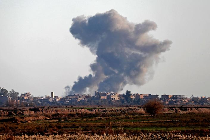 Smoke billows after bombings in the province of Deir Ezzor, near Hajin, eastern Syria, on Dec. 15. Kurdish-led forces seized the Islamic State's main hub of Hajin on Dec. 14. (Photo: Delil Souleiman AFP/Getty Images)