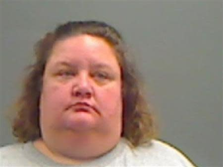 Teri Pallat, 39, of Council Bluffs, Iowa is pictured in this handout booking photo