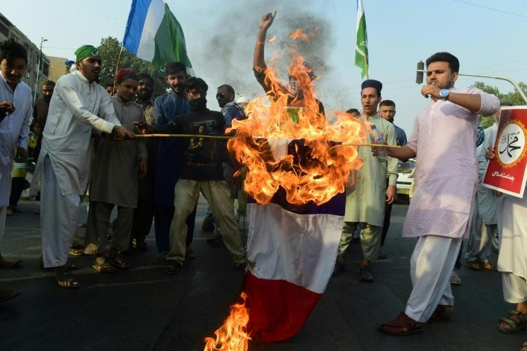 Protests against France continued on Sunday, with activists from an Islamic party seen here burning a French flag in Karachi, Pakistan.