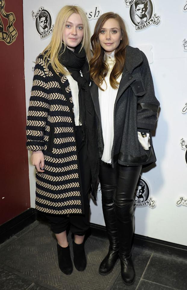 "PARK CITY, UT - JANUARY 23:  Actors Dakota Fanning and Elizabeth Olsen attend ""Very Good Girls"" Official Cast and Filmmakers Lunch Sponsored by Fresh on January 23, 2013 in Park City, Utah.  (Photo by Michael Loccisano/Getty Images)"